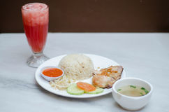 Chicken Rice. Rice with steamed chicken and some vegetables royalty free stock images