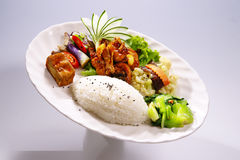 Chicken rice with tofu and cabbage, broccoli on white plate in w Stock Photo