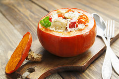 Chicken with rice and vegetables baked in the pumpkin Stock Photography