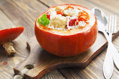 Chicken with rice and vegetables baked in the pumpkin Stock Images