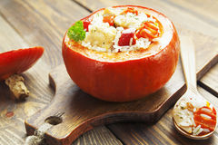 Chicken with rice and vegetables baked in the pumpkin Stock Photos