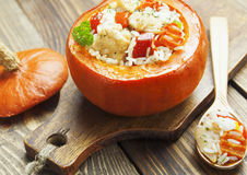 Chicken with rice and vegetables baked in the pumpkin Royalty Free Stock Photo