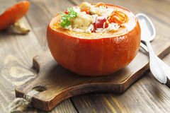 Chicken with rice and vegetables baked in the pumpkin Stock Photo