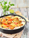 Chicken with rice and vegetables in a frying pan spices Stock Photo