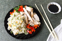 Chicken with rice and vegetables on a plate Royalty Free Stock Photos
