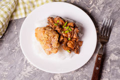 Chicken with rise and mushrooms Stock Photo