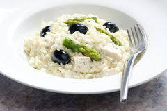 Chicken rissoto. With asparagus and olives Royalty Free Stock Images