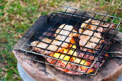Chicken roast on charcoal brazier Stock Photography