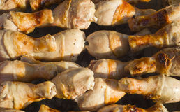 Chicken. Roast leg of young domestic chicken over hot coals on the street Royalty Free Stock Image
