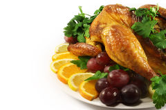 Chicken roasted. On a platter with grapes, oranges, lemon Royalty Free Stock Photo