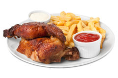 Chicken roasted with fries Royalty Free Stock Photos