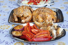 Chicken roasted on grill with garnish Royalty Free Stock Photography