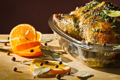 Chicken roasted with herbs serve with orange fruit Stock Photography