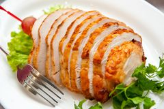 Chicken roll, beautifully sliced on a plate royalty free stock image