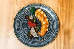 Chicken roll in a black plate stock image