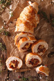 Chicken roll with cheese and sundried tomatoes close-up. vertica Royalty Free Stock Photos