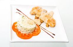 Chicken roll with rice and tomatoes. On white background Royalty Free Stock Photo