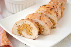 Chicken roll stuffed with pumpkin and nuts Stock Photos