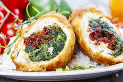 Chicken roll stuffed with spinach and dried tomatoes Royalty Free Stock Photos