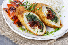 Chicken roll stuffed with spinach and dried tomatoes Stock Photo