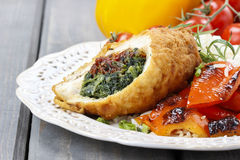 Chicken roll stuffed with spinach and dried tomatoes Royalty Free Stock Image