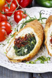 Chicken roll stuffed with spinach and dried tomatoes stock photography
