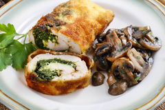 Chicken roll stuffed with spinach and roasted mushroom royalty free stock photo