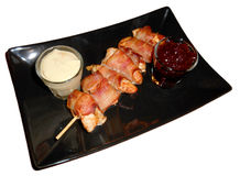 Chicken rolled up with bacon and sauces isolated on white Royalty Free Stock Photography