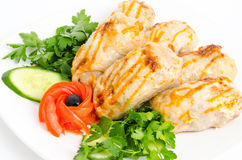 Chicken rolls. Roasted chicken rolls served with fresh vegetables royalty free stock images