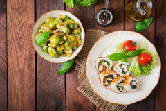 Chicken rolls with greens, garnished with salad. Royalty Free Stock Photo