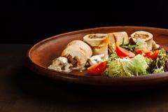 Chicken rolls with mushrooms. stock photos