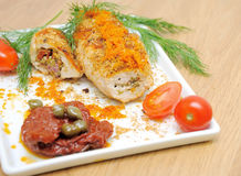 Chicken rolls and vegetables on the plate Stock Images
