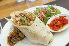 Chicken roti. Chicken curry roti wrap with salad and relish Stock Photography