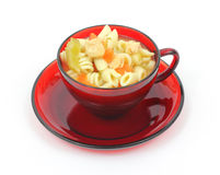 Chicken rotini pasta soup in red cup Royalty Free Stock Image