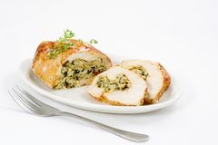 Chicken roulade. Chicken breast filled with white and wild rice, spinach, mushrooms, cheese and spices Stock Photo
