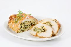 Chicken roulade. Chicken breast filled with white and wild rice, spinach, mushrooms, cheese and spices Stock Photography