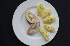 Chicken roulade with herb potatoes Stock Images