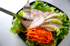 Chicken roulade on salad Stock Images