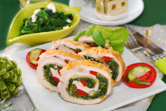 Chicken roulade with spinach for christmas. Chicken roulade with spinach,cheese and red pepper for christmas dinner Stock Image