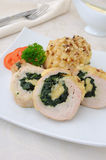 Chicken roulade stuffed with spinach and cheese Stock Images