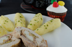 Chicken roulade with tea and muffin Stock Photo