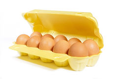 Chicken's eggs in box yellow color on white background Royalty Free Stock Images
