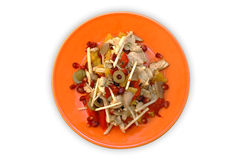 Chicken salad. Chicken, celery, pomegranate, orange, olive and pepper salad on orange plate (clipping path stock photos