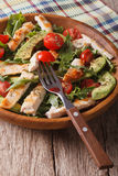 Chicken salad with avocado, arugula and tomato closeup. Vertical Royalty Free Stock Images