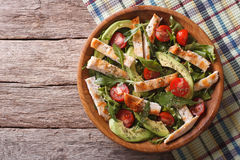 Chicken salad with avocado, arugula and tomatoes. horizontal top stock images