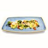 Chicken salad on blue plate. Stock Photos