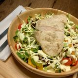 Chicken salad bowl. Chicken salad healthy food in wood bowl on wood table Royalty Free Stock Photography