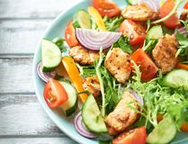 Chicken salad with cherry tomatoes, cucumber, endive, yellow and orange pepper and red onion. Concept for healthy eating and nutri. Tion. Horizontal royalty free stock images