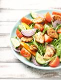 Chicken salad with cherry tomatoes, cucumber, endive, yellow and orange pepper and red onion. Concept for healthy eating and nutri. Tion. Horizontal stock photo