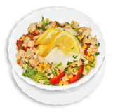 Chicken salad. Dish with vegetables and sour cream sauce, isolated on white Royalty Free Stock Photo